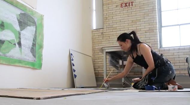 Lucy Liu working in her art studio (video screen capture)