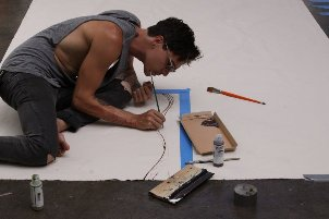 Brandon Boyd creating canvas for TOMS Shoes